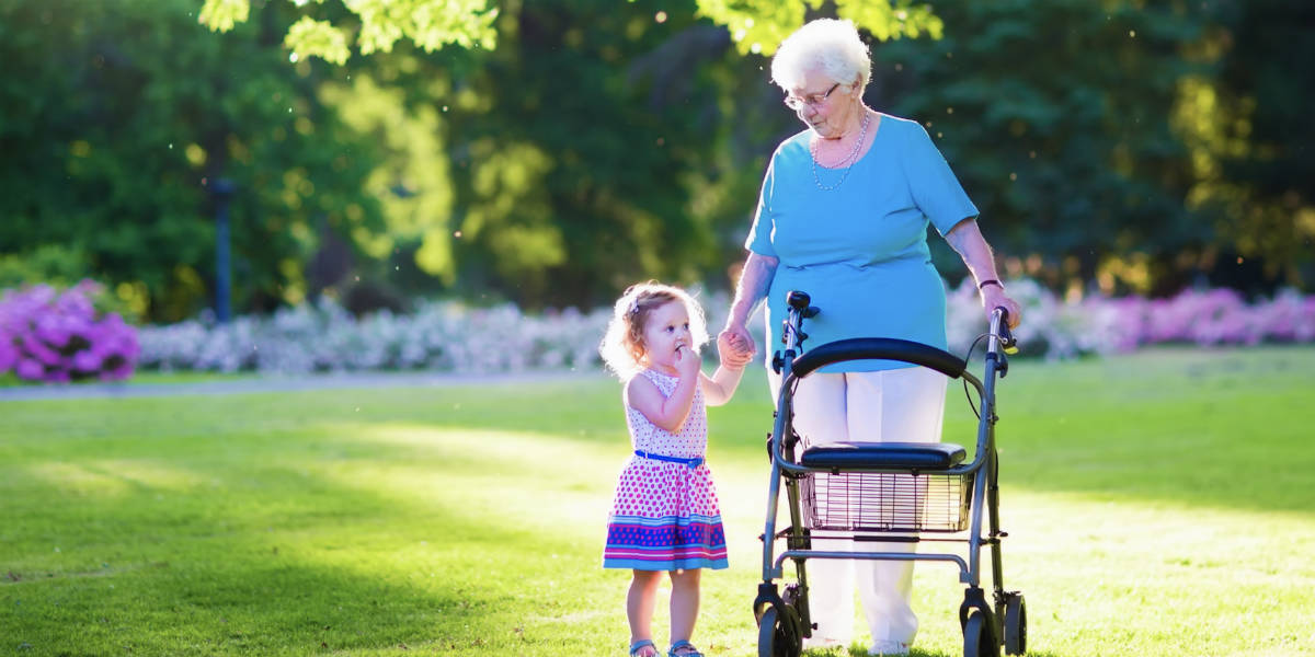 Senior-citizen-woman-on-walker-with-grandchild